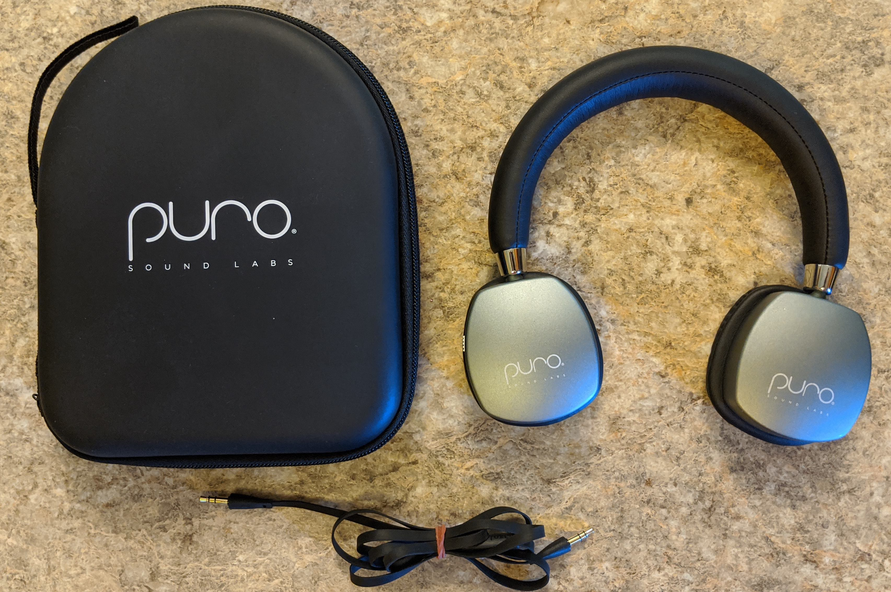 PuroQuiet headphones with case and phono cable.